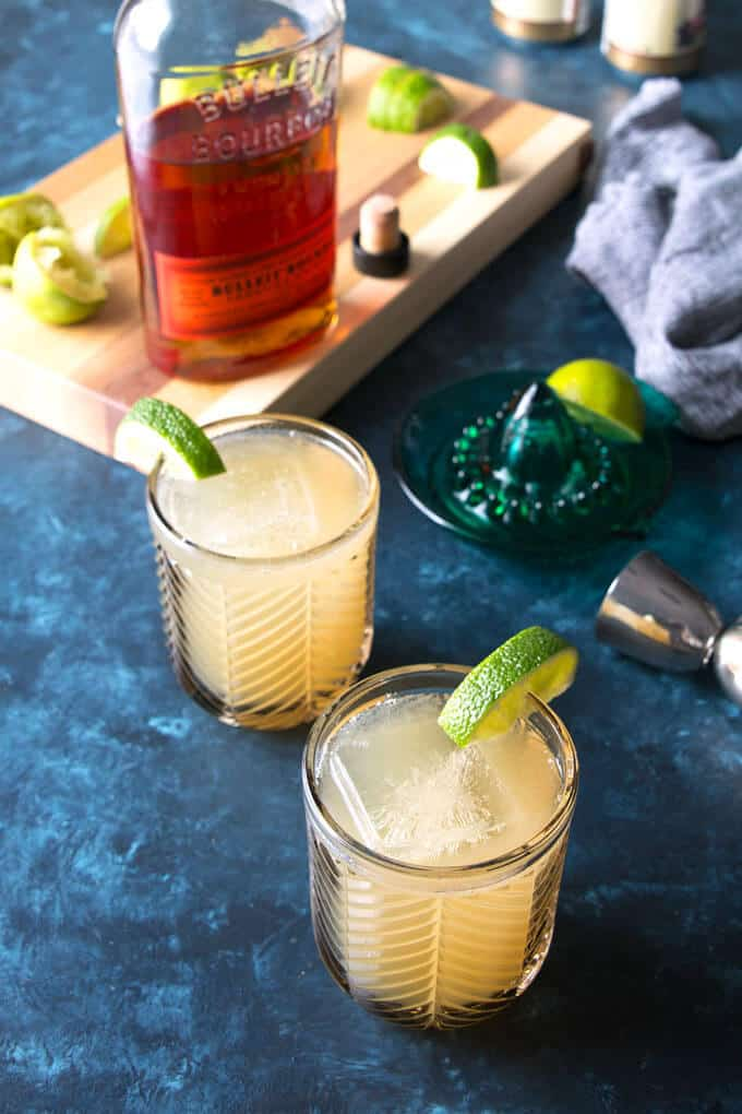 Kentucky Mule recipe in two glasses with all of the ingredients