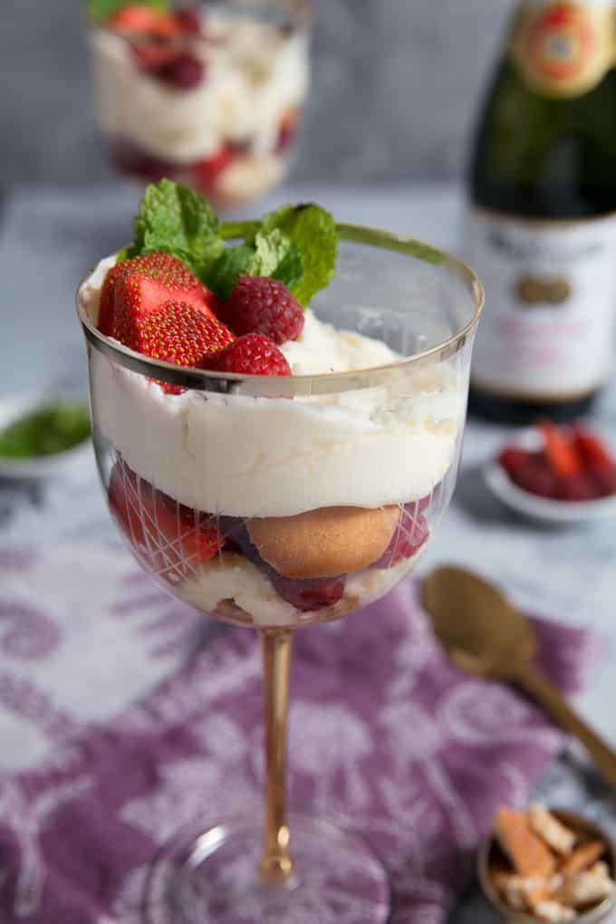 Raspberry Strawberry Parfaits with Sparkling Cider Frosting in a wine glass