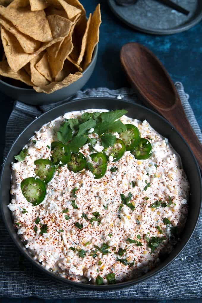corn dip in a grey bowl