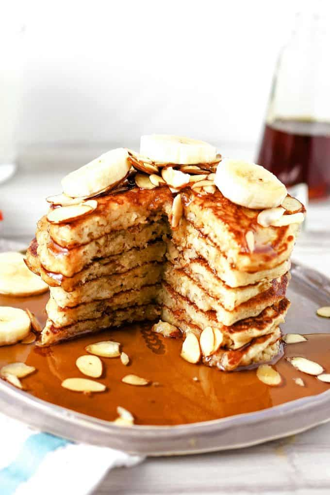 stack of almond banana pancakes with a section cut out