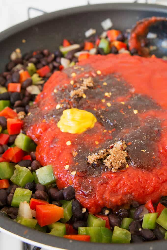 all of the ingredients for black bean sloppy joes in a pan