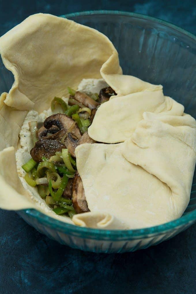 photo of leek mushroom cheese stuffed puff pastry preparation