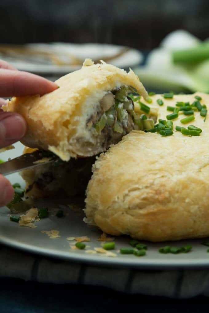 picture of leek mushroom cheese stuffed puff pastry piece being removed