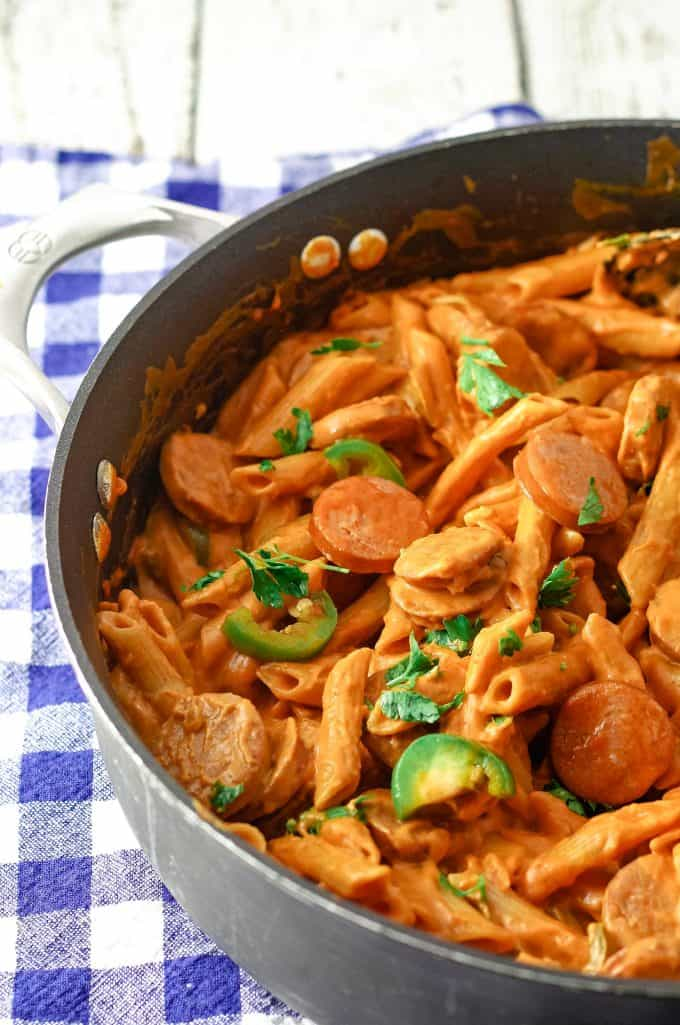 one pot spicy sausage pasta skillet in a black skillet