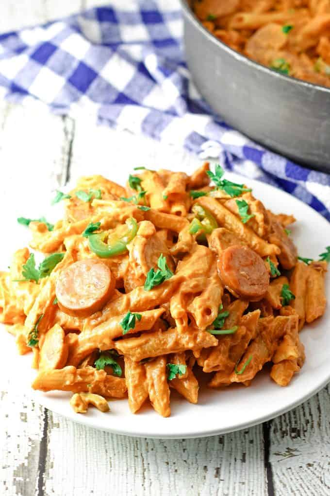 white plate of spicy sausage pasta