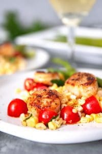 seared garlic scallops and a glass of white wine