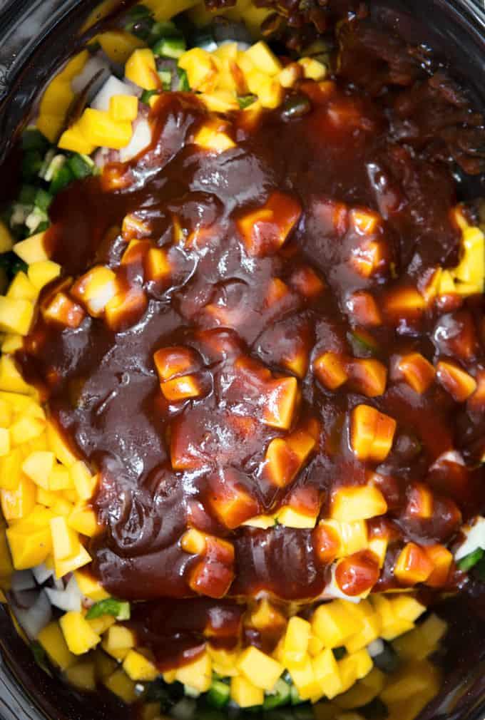 bbq sauce on top of mango chunks