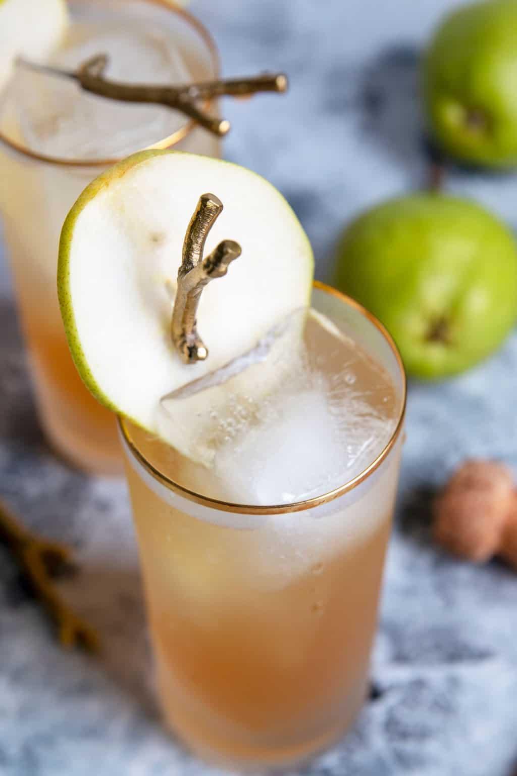 pear garnish in a sparkling bourbon pear cocktail