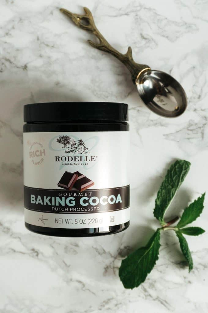 Rodelle gourmet baking cocoa and a mint sprig