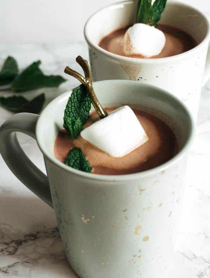 two mugs of boozy mint hot chocolate