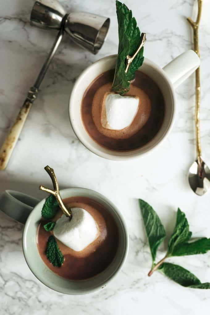 overhead photo of two cups of boozy mint hot chocolate