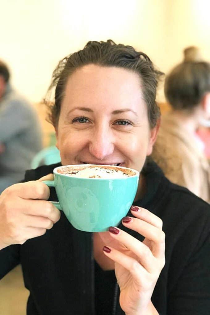 Jenny drinking a mug of hot chocolate