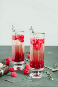 2 raspberry kir royale cocktails in tall glasses
