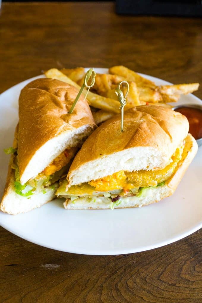The Best Downtown Charleston Restaurants - Amen Street Fish and Raw Bar fried green tomato sandwich