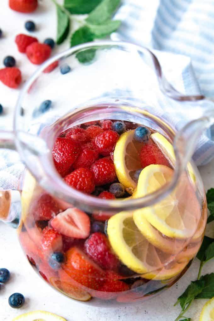 up close photo of berry rosé sangria pitcher