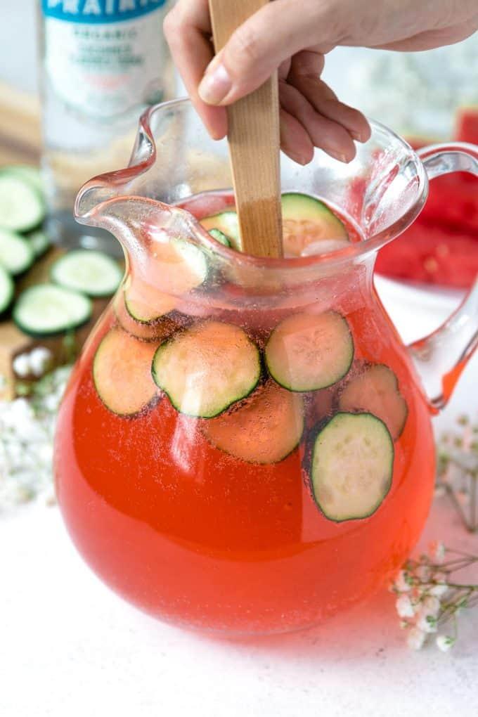 cucumber watermelon punch being stirred