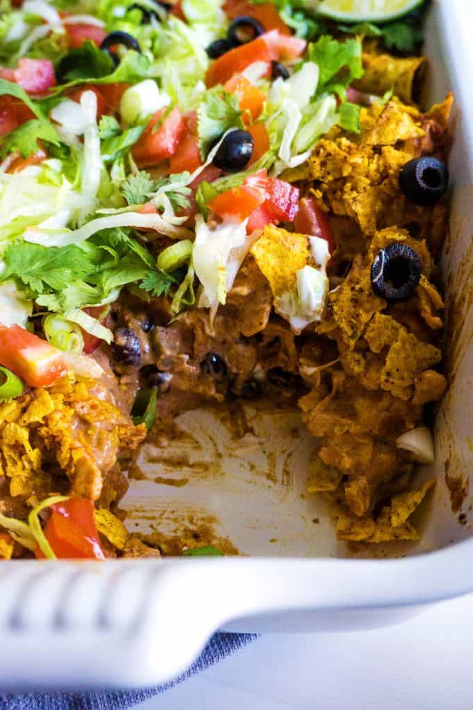 chicken taco casserole in a white casserole dish