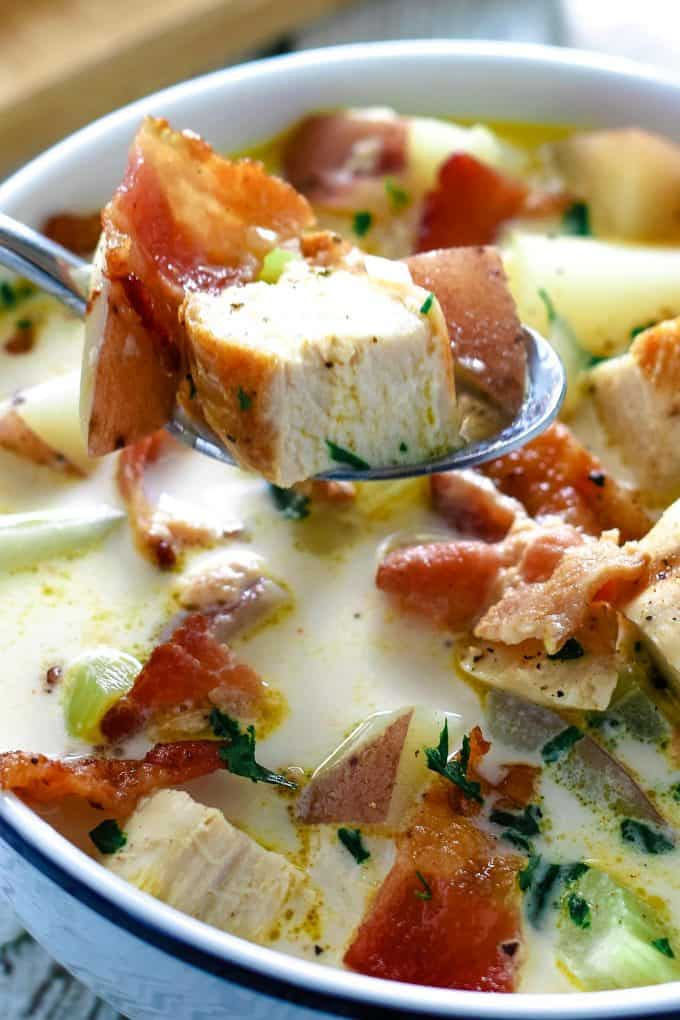 soup full of chicken potato chowder over a bowl of soup
