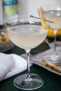 single gin ginger martini garnished with candied ginger