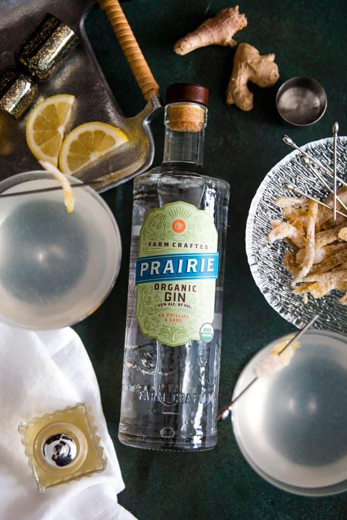 two gin ginger martinis a bottle of Prairie Organic Spirits gin and garnishes