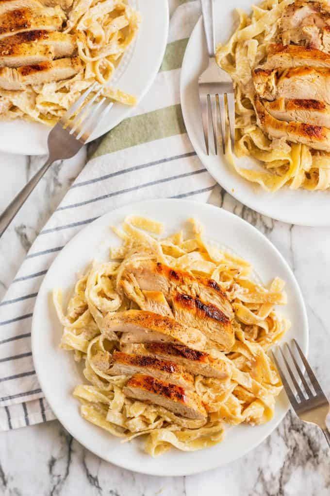 three plates of creamy chicken tagliatelle