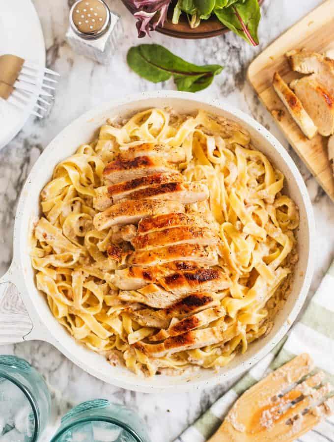creamy chicken tagliatelle in a white pan