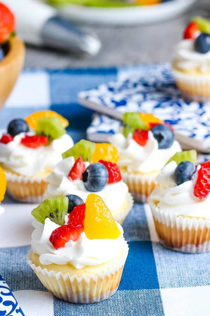 mini cheesecakes topped with fruit
