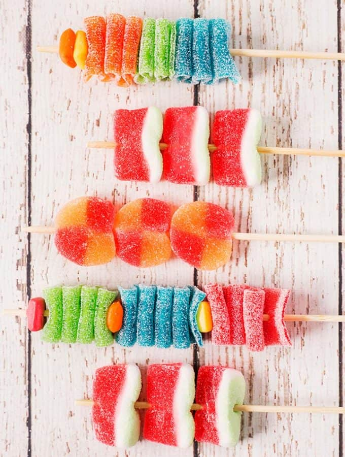 5 assembled candy kabobs on wooden skewers