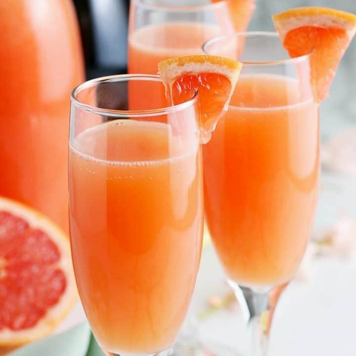 forward facing photo of grapefruit mimosas garnished with fresh grapefruit