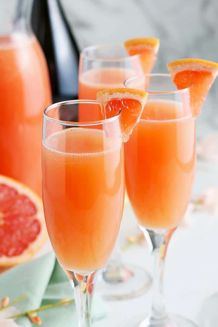 forward facing photo of grapefruit mimosas garnished with fresh grapefruit