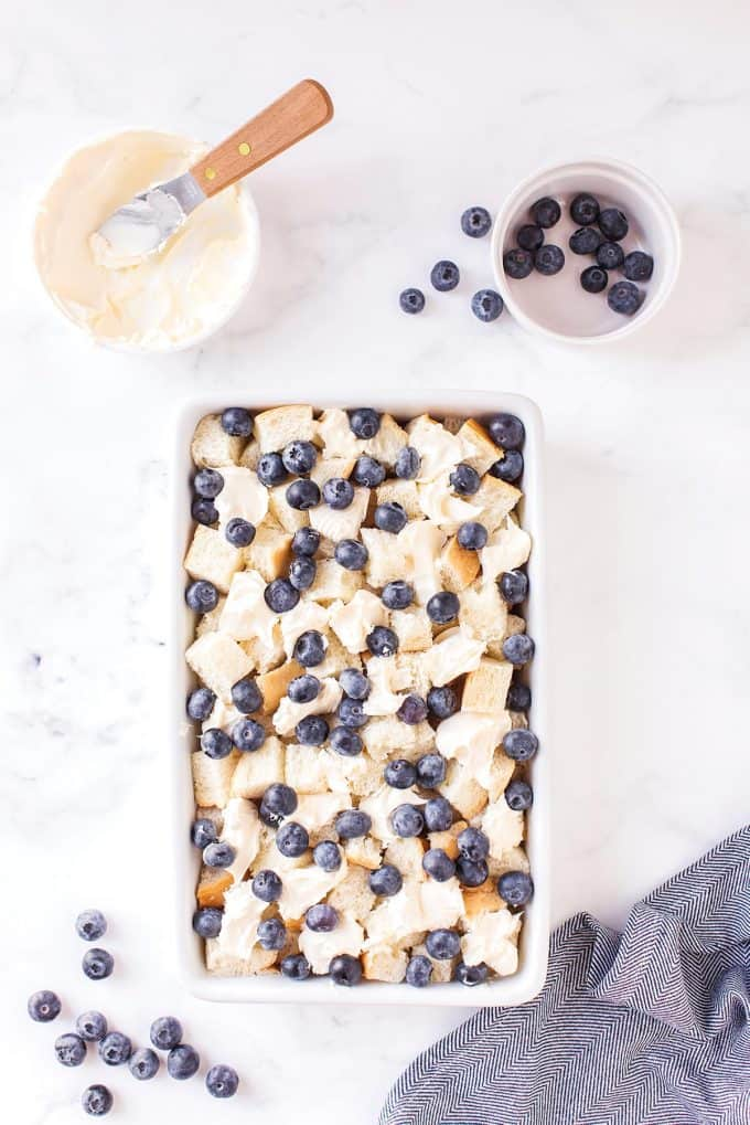 fresh blueberries, marscapone and blueberries in a baking dish