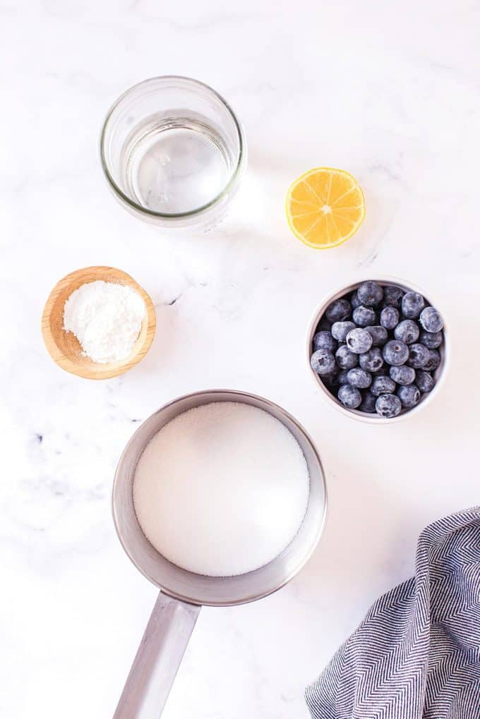 all of the ingredients for homemade blueberry syrup