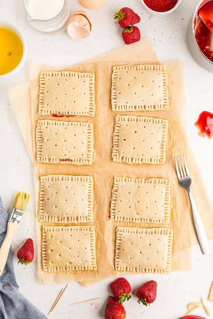 using a fork to press the edges of the dough together and poking holes into the tops of each pop tart