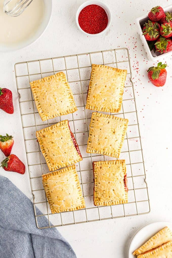 homemade strawberry poptarts fresh out of the oven on a cooling rack