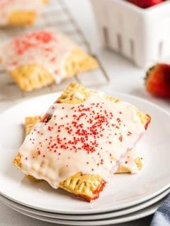 two strawberry pop tarts on a white plate